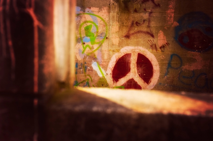 Peace Graffiti on City Street Wall